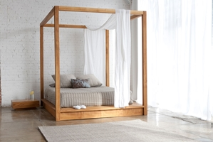 Maggie Canopy Bed Create the ultimate secluded place of rest with the Maggie Canopy Bed.