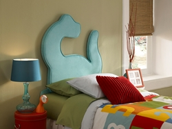Dinoroar Twin Platform Bed The Dinoroar Twin Platform Bed will brighten up any kid's room with some prehistoric fun. The dinosaur headboard comes fully upholstered in funky turquoise polyester.