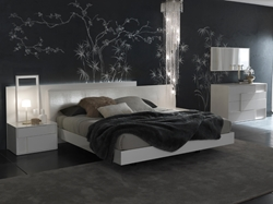 White Irwin Leather Platform Bed Fit for royalty, our Irwin Platform Bed takes modern bedroom furniture to a whole other realm. Its dazzling design elements like its off center headboard, low rise headboard and dark mystique will have you sleeping in style.