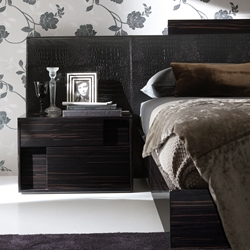 Irwin Nightstand Chic, modern, stylish, functional  all of these and more describe the Irwin Nightstand to a T. Its two spacious drawers feature alternating crocodile-pattern leatherette design for style and soft-close hinges for durability.