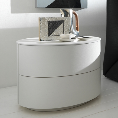 Luna Nightstand Here to stylize your bedside area, the Luna Nightstand is round and fun shaped for a new and modern style of storage space. Made from solid wood with a glossy white lacquer finish, youll have a plenty of space for storing your things while adding to the sleek style of your bedroom.